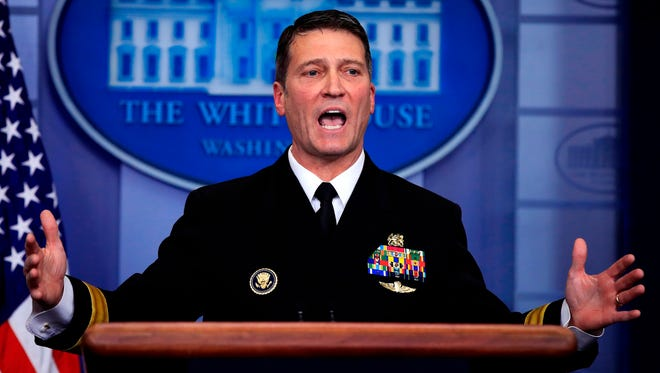 White House physician Dr. Ronny Jackson speaks to reporters during the daily press briefing in the Brady press briefing room at the White House, in Washington. The doctor to Presidents George W. Bush, Barack Obama and now Donald Trump is an Iraq War veteran nominated to head the Department of Veterans Affairs. Jackson's confirmation hearing is being postponed to give lawmakers more time to examine information related to his service as a physician.
