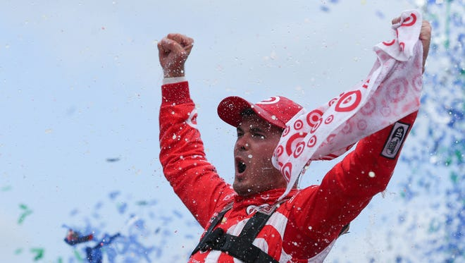 Kyle Larson celebrates his  victory in the Pure Michigan 400 at the Michigan International Speedway.