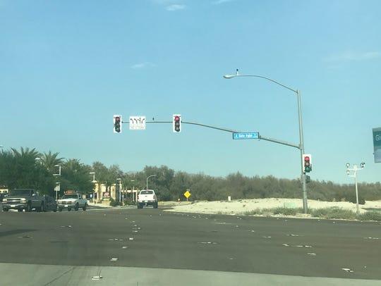 A sign warns drivers of new striping at Vista Chino