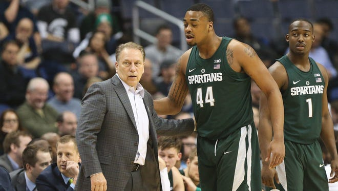 Michigan State coach Tom Izzo talks to forward Nick Ward in the second half MSU's 63-58 loss in the Big Ten tournament Friday in Washington.