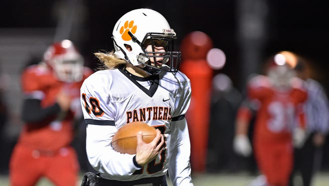 East Pennsboro quarterback Payton Morris keeps the ball against Susquehannock in the first half of a PIAA District 3 first-round game Friday, Nov. 10, 2017, at Susquehannock. Susquehannock lost 45-14 to East Pennsboro in the Warriors' first playoff appearance since 2006, ending their first winning season since 2007.