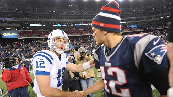 Indianapolis Colts Andrew Luck,left, greets New England Patriots QB Tom Brady,right, following their game Sunday evening at Gillette Stadium in Foxobrough MA.