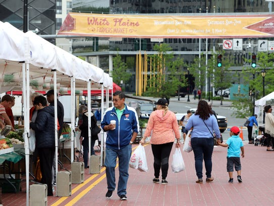 People shop at the White Plains farmers market May