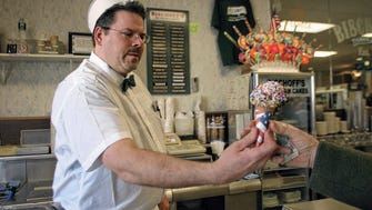Steven Mather works the counter at the restaurant, candy shop and ice cream parlor his great grandfather, Albert Bischoff, opened.
