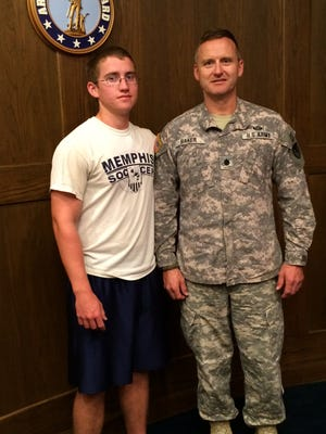 Lt. Col. Sherwood Baker poses with his son in the same uniform he wore when security personnel at his daughter's high school denied him entry.