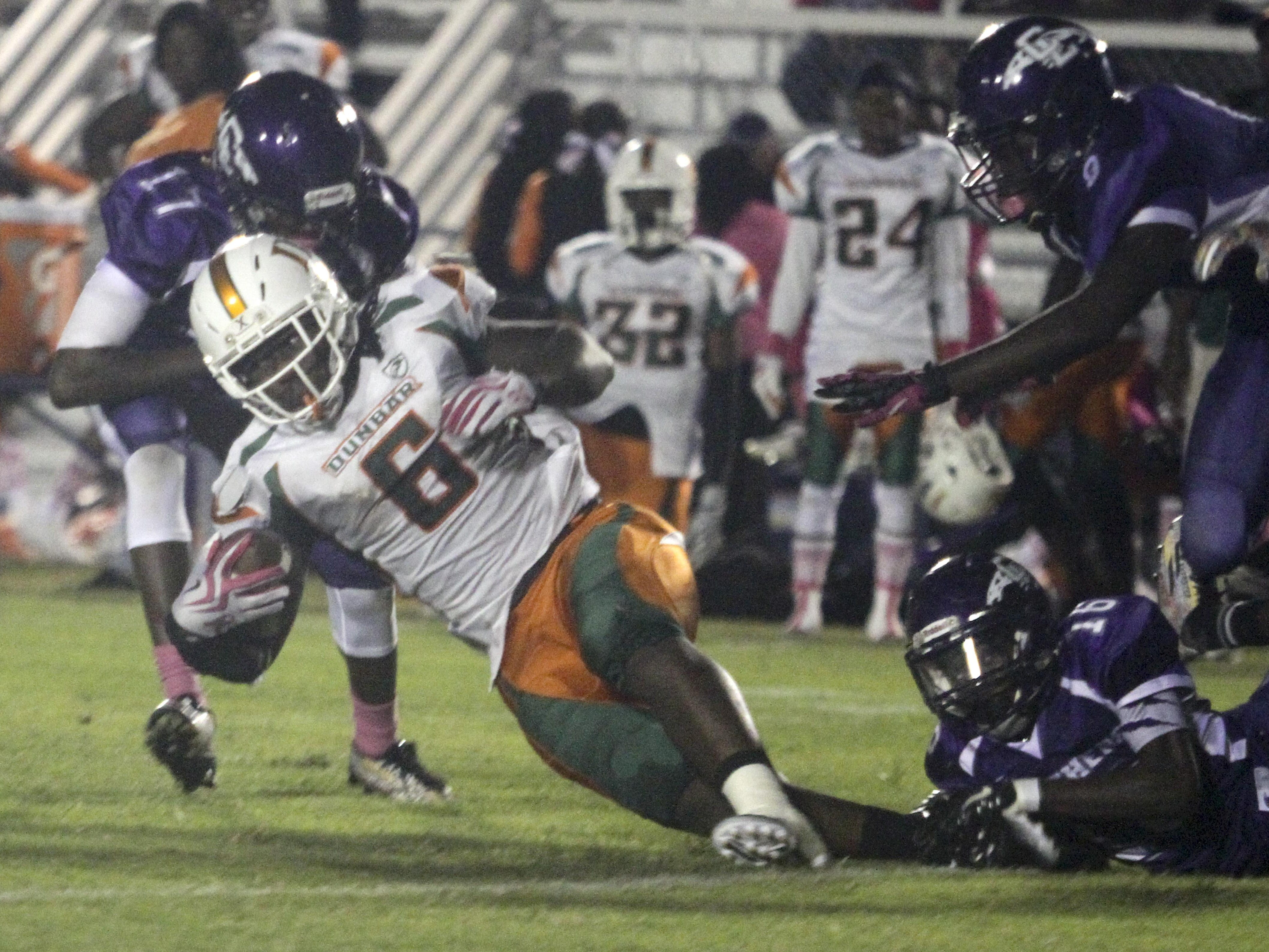 Dunbar's Abraham Alce runs the ball against Cypress Lake. Alce finished with 206 yards and a touchdown.