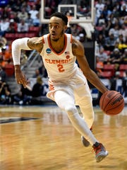 Clemson guard Marcquise Reed moves the ball upcourt during the first half of a first-round NCAA college basketball tournament game against New Mexico State, Friday, March 16, 2018, in San Diego.