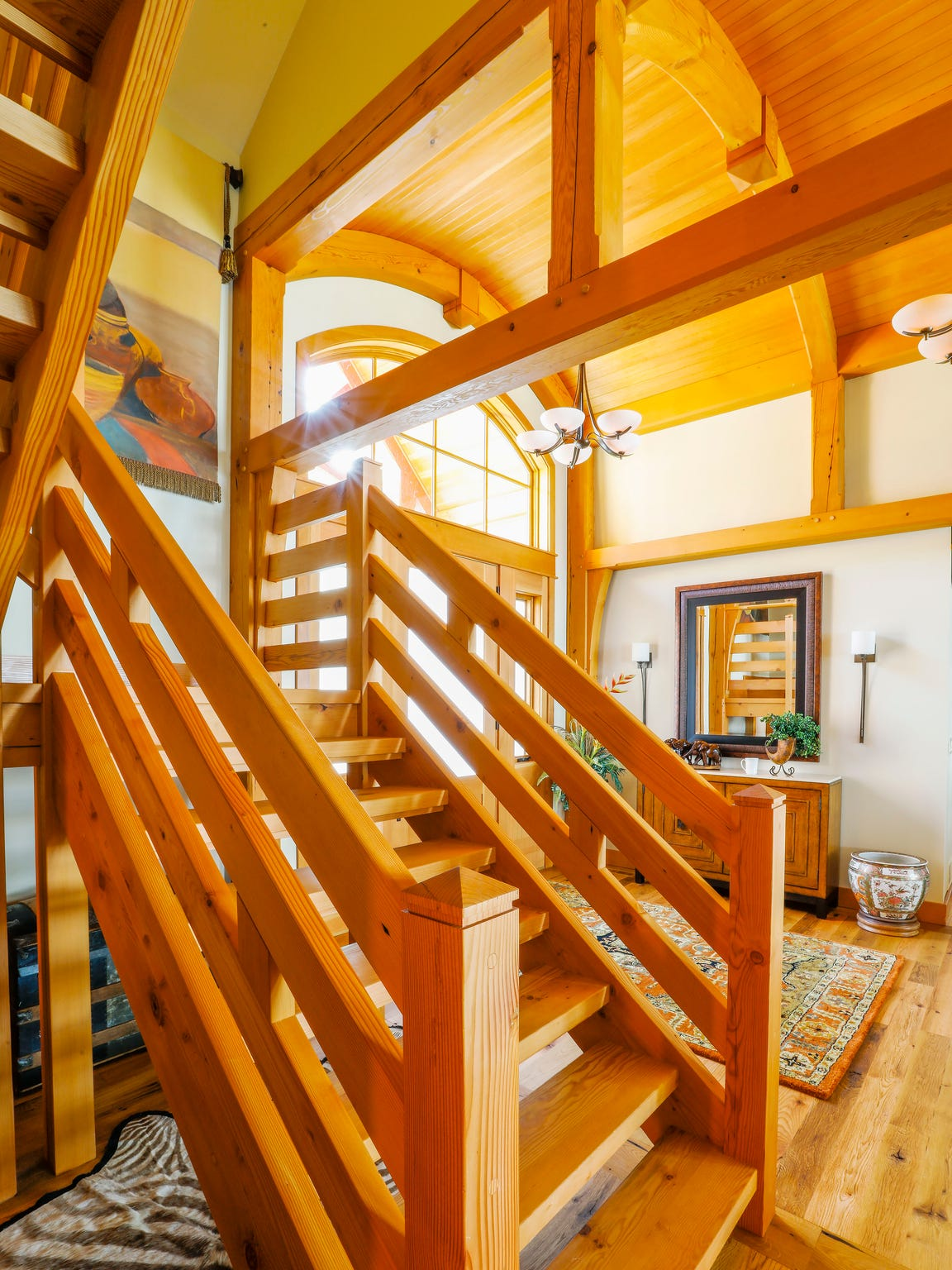 Arching ceilings accentuate the Craftsman-style design.