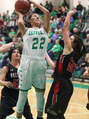 Wall's Sam Rocha (22) and Ballinger's Kinlee Bowman, right, were named co-Offensive MVPs for District 4-3A girls basketball in 2018.