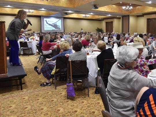 "U.S. Army Blackhawk Helicopter pilot Elizabeth McCormick playfully takes the women through a crash course of what it's like behind the controls of the helicopter during her motivational talk Wednesday, Aug. 9, 2017. The author was the keynote speaker for the eighth annual ""Celebrate Women!'' luncheon hosted by Women's Fund of Door County."