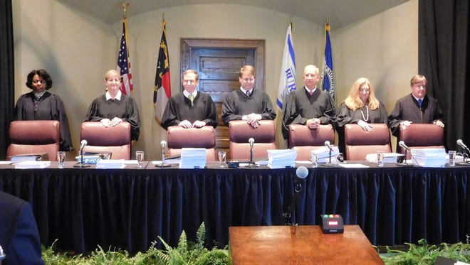 The members of the state Supreme Court stand at the beginning of a special court session held in Morganton Tuesday. A lawsuit over control of the Asheville water system was the first case the court heard during a two-day visit to the city.