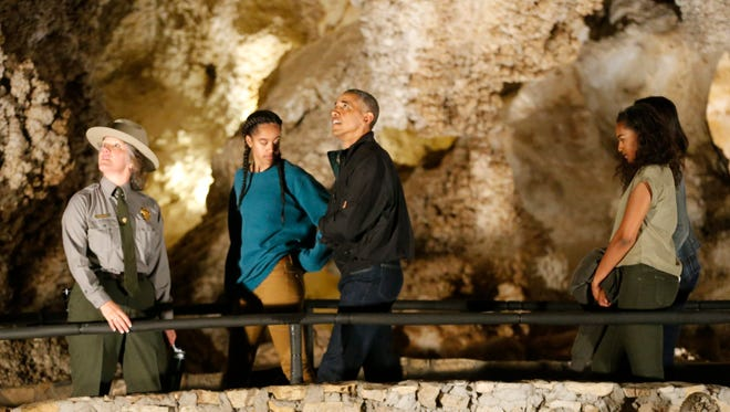 President Barack Obama and first lady Michelle Obama and their two daughters take a tour with Carlsbad Caverns National Park public affairs specialist Valerie Gohlke on Friday afternoon during a brief stop in celebration of the centennial anniversary of the National Park Service.
