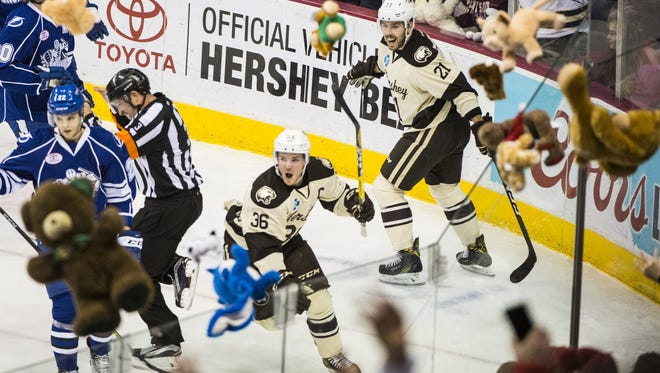 Garrett Mitchell of Hershey (36) celebrates his goal as stuffed animals rain down on the ice during the annual Teddy Bear Toss. Fans set a new record by tossing 20,662 stuffed animals onto the ice.