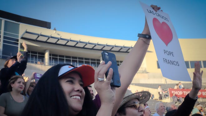Antoinette Fuentes, left, and her mother Pauline Garcia, cheer seeing the arrival of the pope in Juarez on the UTEP Sun Bowl's video screen. Fuentes, Human Resources Director for the Roman Catholic Diocese of Las Cruces, was one of 18 members of the diocese staff who attended the simulcast which was attended by 28,000 people.