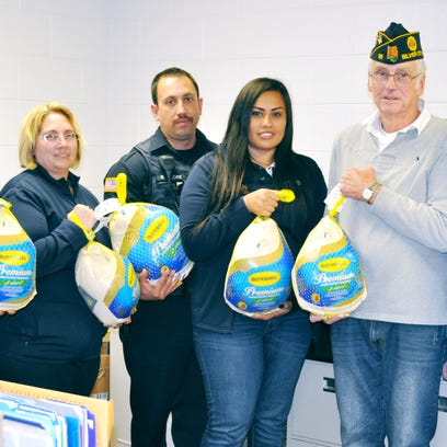 The Silver City Police Department, along with the American Legion Allingham-Golding Post 18, prepared Thanksgiving food baskets for needing families. Holding turkeys are, from left, SCPD Capt. Ricky Villalobos, SCPD staff member Kristin Medina, Officer Richard Flores, staff member Angelic Guerrero, American Legion Post 18 representative Ray Davis, and SCPD Chief Ed Reynolds.
