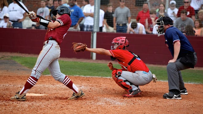 USJ's Will Jones, seen catching in this photo, had a three-RBI triple in the seventh inning against Davidson Academy. USJ won 18-13 to advance to the state tournament.