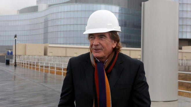 In this Tuesday, April 7, 2015, file photo, Glenn Straub stands outside the Revel casino-hotel, which he bought for $82 million, in Atlantic City, N.J. Since Straub bought the Revel casino for about 4 cents on the dollar in April, it has brought him nothing but trouble, And he's fine with that.