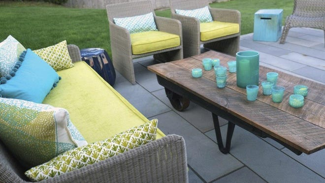 Sofas and chairs with deep, padded seats can help you enjoy fall outdoor spaces.
