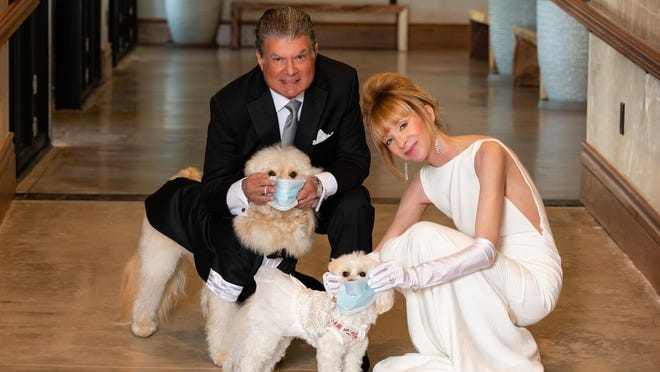 Mara Schainuck and Arthur Benjamin, along with their pets Charlie and Lexi, pose in their wedding outfits, which they would have worn April 4 but will wear later this year in a rescheduled celebration.