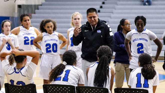 Then assistant coach Rudy Toledo talks to the Wellington girls basketball team last season.