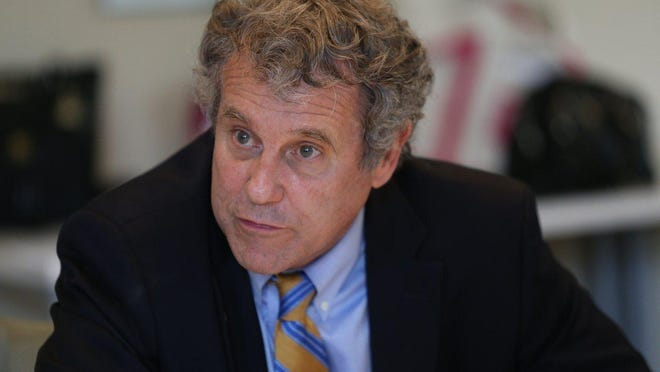 Ohio Sen. Sherrod Brown listens to the concerns of a Comprehensive Women's Care health-care provider during a roundtable discussion in Columbus in September 2019.