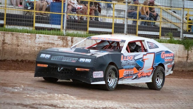 """Race car driver Grant Davis of Muldrow rides his car, """"Slope Back Sally,"""" at a recent race at Tri-State Speedway in Pocola. Davis has won the last two Factory Stocks races at the speedway, and is going for three straight wins Saturday night."""