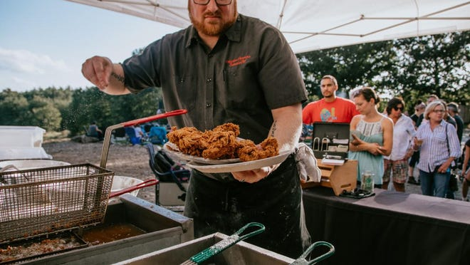 Chef Matt Provencher, of the Foundry Restaurant, cooks up Vernon Fried Chicken during a recent fried chicken Friday event.