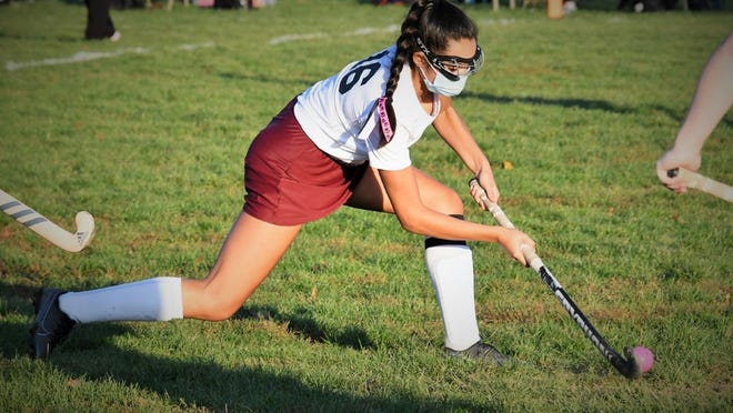 Tiverton High School senior Angelin Santerre advanaces the ball during Wednesday's field hockey game against Burrillville.