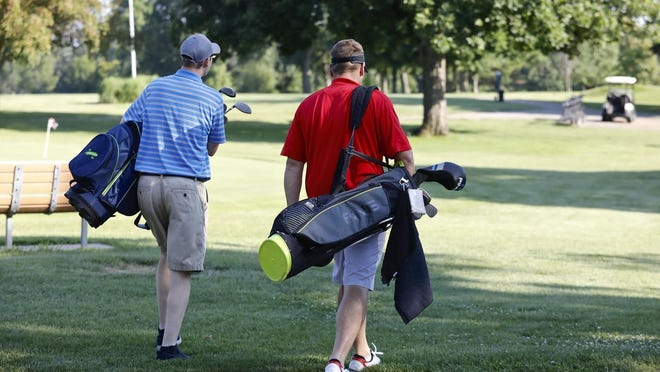 A pair of golfers head out to play an evening round in July 2018 at Sinnissippi Golf Course in Rockford.