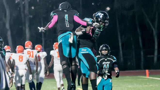 John Dickerson IV of Islands celebrates a touchdown with a teammate in a win over Johnson at Islands on Oct. 8.