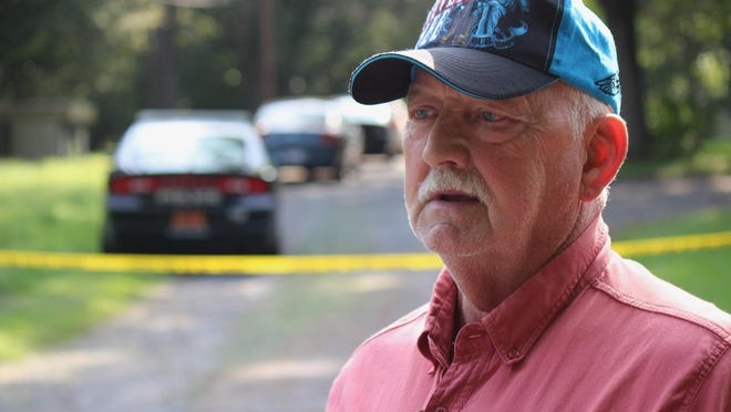 Edgar Phillips, who said his brother died in a stabbing Wednesday morning in Gastonia, speaks with reporters in the 600 block of Log Cabin Drive.