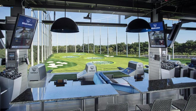 Up to six golfers can play out of a bay at Topgolf, and up to eight people total can occupy each space.