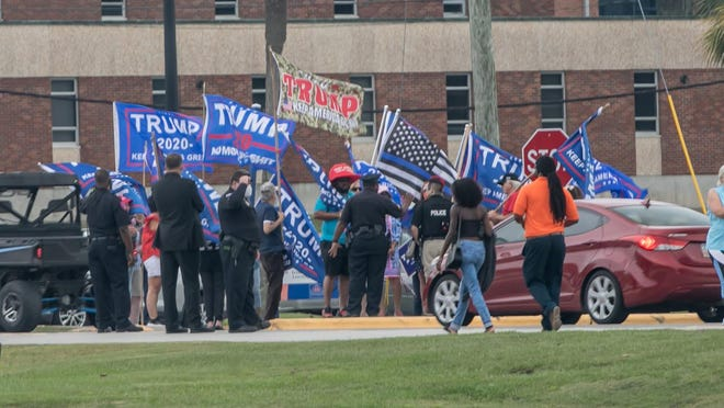A small group of supporters for President Donald Trump gathe on the Savannah State University campus during Monday's Jill Biden rally.
