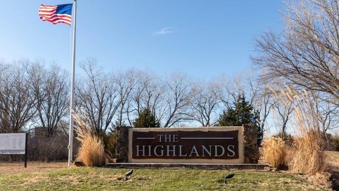Residents of The Highlands last weekend finished installing this new city entrance sign, built with volunteer labor and donations.
