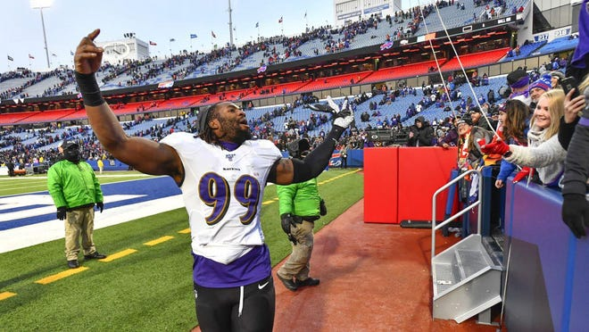 Baltimore Ravens outside linebacker Matt Judon (99) celebrates a 24-17 win over the Buffalo Bills after an NFL football game in Orchard Park, N.Y., Sunday, Dec. 8, 2019.
