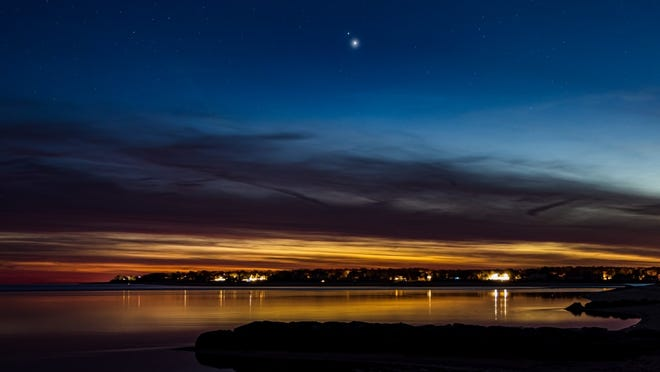 Dan Jentzen shared this picture he took of Jupiter (the brighter planet) and Saturn on Dec. 15, as they neared their closest approach on Dec. 21. This picture was taken in Cotuit, looking across to Poponesset, on Cape Cod, Massachusetts.
