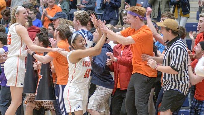 Arika Tolbert (center) high-fives fans at DeVos Fieldhouse.