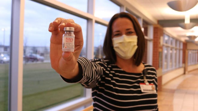 Linda Schaltz, chief nursing officer, holding the first vial of vaccine given at Zeeland Community Hospital.