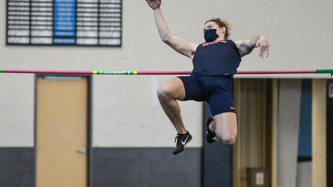 Hope College's Jackson Player competes in the high jump