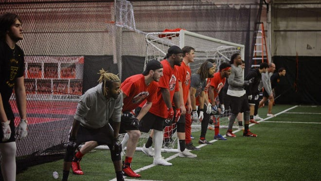 Players line up for drills during the first practice for the Southeast Michigan Red Storm - a new semipro football team in Monroe County - at LevelUp Training Complex Sunday.