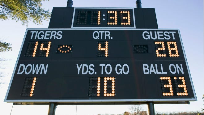 Football Scoreboard --- Image by © Royalty-Free/Corbis