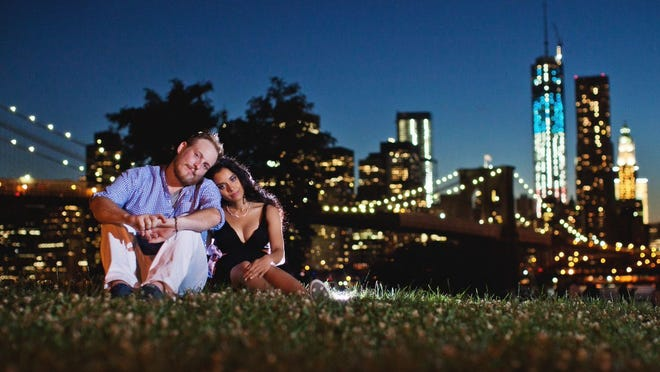 Kristain and Anzalee Rhodes hired I Heart New York to document their experiences as young parents. Anzalee was eight months pregnant in this picture of the couple at Brooklyn Bridge Park, in New York.