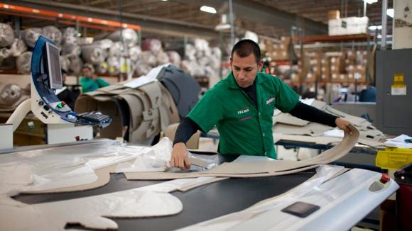 FILE PHOTO: Marcos Godoy of Mexico City manufactures