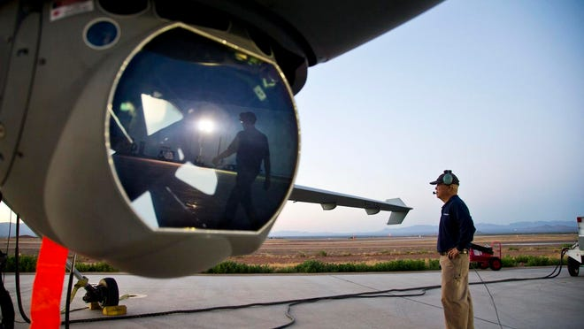 Crews work on a Customs and Border Protection aircraft. A CBP plan for the Arizona-Mexico border came under fire Wednesday.