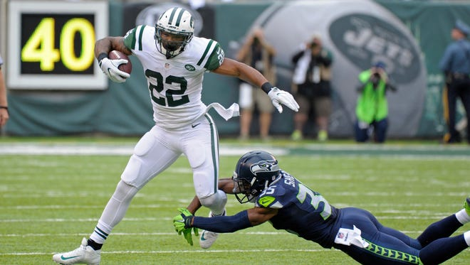 New York Jets running back Matt Forte (22) slips out of a tackle by Seattle Seahawks' DeShawn Shead during the first half of an NFL football game Sunday, Oct. 2, 2016, in East Rutherford, N.J.