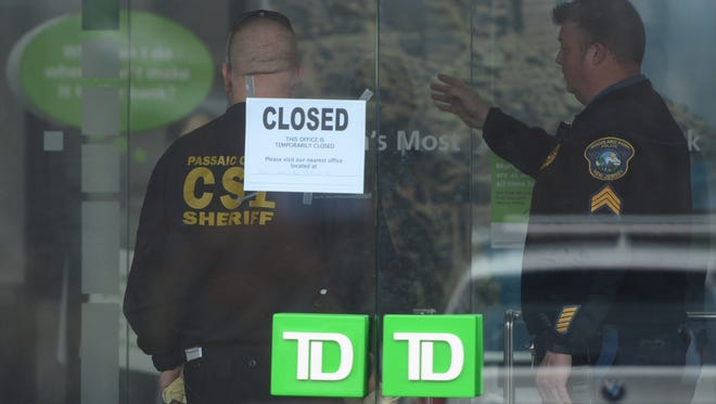 Authorities at the TD Bank at McBride and Lackawanna avenues in Woodland Park after Thursday morning's robbery.