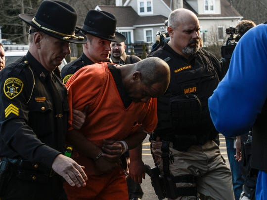 Aaron Powell is led into Binghamton Town Court on March