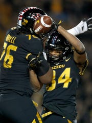 Missouri's Emanuel Hall (84), right, is congratulated by teammate Tyler Howell after catching a touchdown pass during the first half of an NCAA college football game against Tennessee, Saturday, Nov. 11, 2017, in Columbia, Mo. (AP Photo/Jeff Roberson)