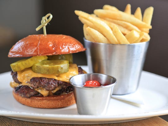 The Fat Lamb's take on cheeseburger and fries has two patties from Paducah, Kentucky's Black Hawk Farms with Duke's Mayo, and horseradish pickles. $16.