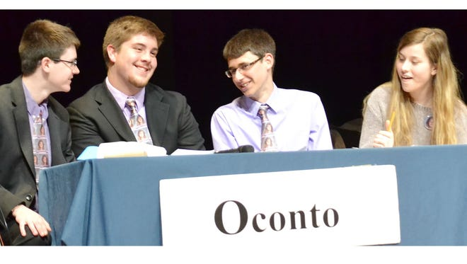 Four members of Oconto High School's Hi-Q team smile Thursday after winning the Regional Championship, held at OHS. From Left are James Alwin, Lucas Ruechel, Alex Maynard and Karly Murphy.